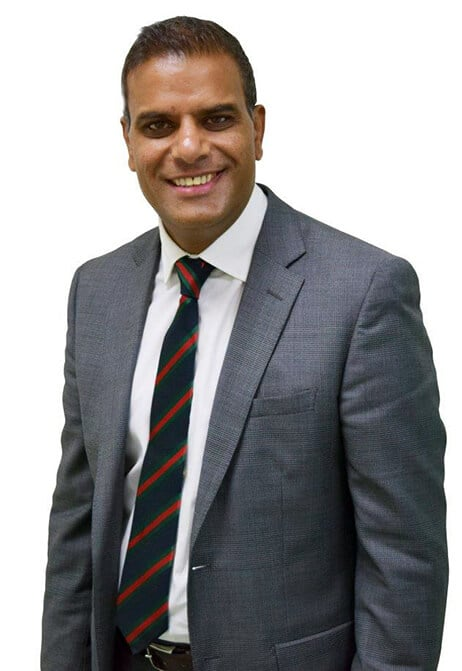 raj bhatia profile picture on white background, wearing nice suit and tie